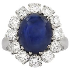 A Cabochon Sapphire And Diamond Cluster Ring