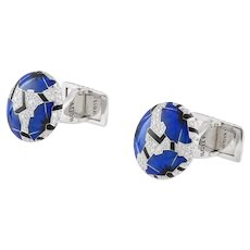 A pair of blue poppies cufflinks by Ilgiz F