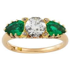 An Early 20th Century Three Stone Emerald And Diamond Ring