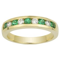 A Yellow Gold Emerald And Diamond Half Eternity Ring