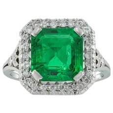 A mid-20th century emerald and diamond cluster ring