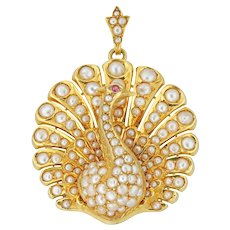 A Victorian Pearl And Ruby Peacock Brooch/pendant