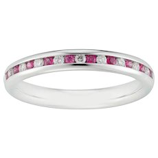 A Pink Sapphire And Diamond Half-eternity Ring
