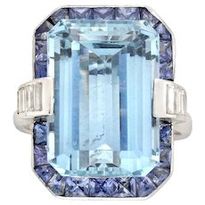 An Aquamarine, Sapphire And Diamond Cluster Ring
