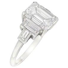 An Emerald Cut Solitaire Diamond Ring