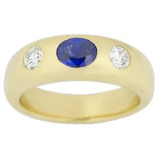 A Sapphire And Diamond Gold Gypsy Ring