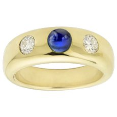 A Gold Sapphire And Diamond Gypsy Ring