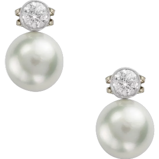 A Pair Of South Sea Cultured Pearl And Diamond Earrings