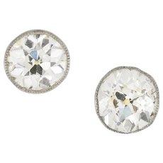 A Pair Of Single Stone Diamond Stud Earrings
