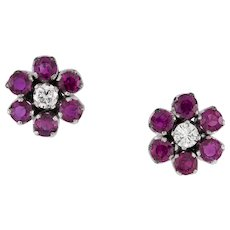 A Pair Of Ruby And Diamond Floral Cluster Stud Earrings