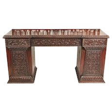 Antique ornate small carved Anglo-Indian padauk inverted breakfront pedestal sideboard