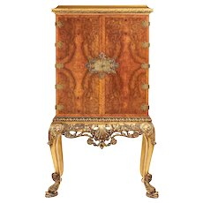 Fine antique walnut and gilt two door cabinet on stand