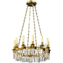 Gilt bronze and crystal 12 light chandelier with scalloped gallery
