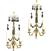Gilded bronze crystal two light sconces with crystal spire and top spray, Sweden late, 19th century