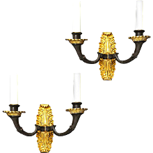 Empire Style parcel gilt two light sconces