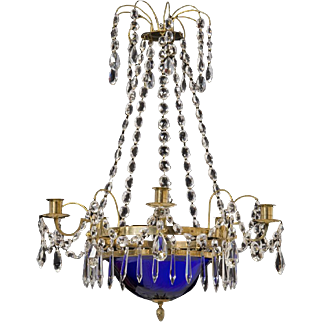 Gilt bronze and crystal five light chandelier with cobalt glass dish