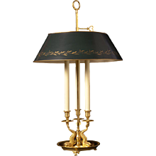 Gilded bronze three light bouillotte with dolphins and painted tole shade. Lead time 14-16 weeks.