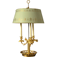 Gilded bronze three light bouillotte with rams head and painted tole shade. Lead time 14-16 weeks.