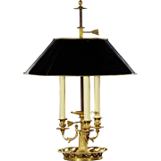 Gilded bronze three light bouillotte with open scroll base. Lead time 14-16 weeks.