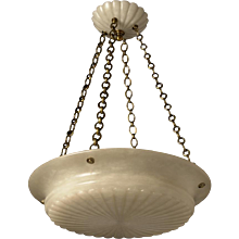 Carved alabaster pendant with gadrooned bottom and matching canopy, eight lights.