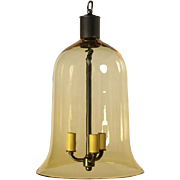 Amber colored crystal bell shaped three light lantern.