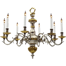 CONTINENTAL Style silver and gilt eight light chandelier. Lead time 14-16 weeks.