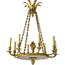 EMPIRE Style gilded bronze with white inset and flame eight light chandelier.Lead time 14-16 weeks.