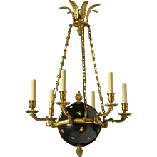 EMPIRE Style black and gilded bronze six light chandelier with stars. Lead time 14-16 weeks.
