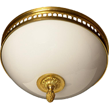 Gilded bronze and opaline glass flush mount with open grill banding
