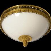 "Gilt Bronze ""Swag & Tasssel"" flushmount with opaline glass, two lights"