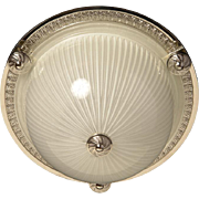 Nickeled bronze and ribbed glass flushmount with button, one light