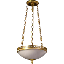 Gilded bronze and opaline glass three light pendant with open circle gallery