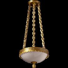 "Gilt bronze ""Swag & Tassel"" motif three light pendant with opaline glass"