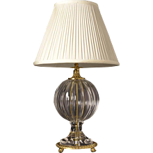 Cut crystal and gilded bronze table lamp with paw feet,