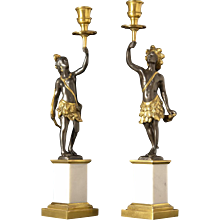"""NUBIAN"" Motif black and gilded bronze candlesticks on marble plinths. Lead time 14-16 weeks."