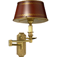 Gilded bronze one light swing arm sconce with painted tole shade