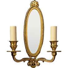 LOUIS XVI Style gilded bronze and mirror back two light sconce