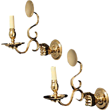 BUTLER, polished brass left and right-hand motif, one light sconce with reflectors. Designed exclusively for The L'Etoile Collection by David Reitner