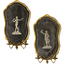 ADAM and EVE motif Venetian style giltwood and gesso two light mirrored sconce