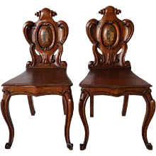 Pair of English Regency Painted Armorial Oak Hall Chairs
