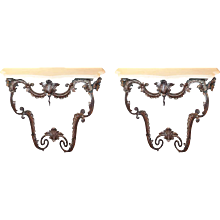 Pair of Italian Rococo Style Polished Steel Limestone Top Consoles