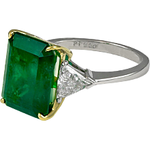 7.11ct Emerald Cut Emerald and Trillion Diamond Ring.