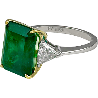 7.11ct Emerald Cut Emerald and Trillion Diamond Ring.