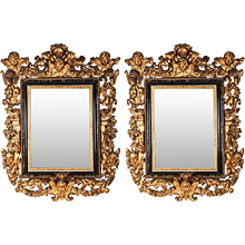 A Very Fine Pair of Italian  17th C. Carved Giltwood Mirrors