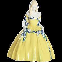 Girl with a Flower Festoon Figurine