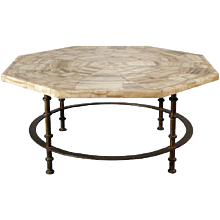 An octogonal coffee table onyx marble top