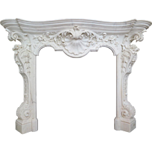 An 18th century English  Rococo Style Statuary White Marble Fireplace