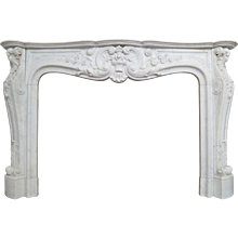 A large French Antique Louis XV Carrara Marble Fireplace
