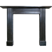 An antique Georgian Irish Black Marble Fireplace Mantel