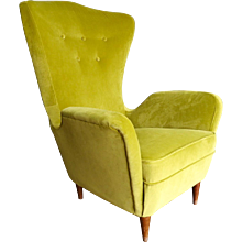 An Italian  wing backed mid century armchair